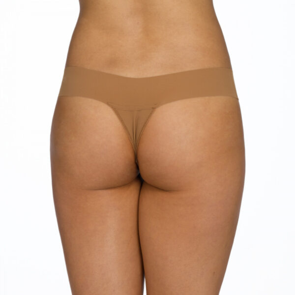 This is a model shown from the waist down (back view) of the Hanky Panky Bare Natural Rise Thong in taupe