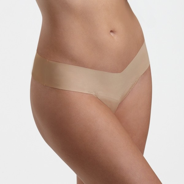 A model shown from the waist down wears the Hanky Panky Bare Natural Rise thong in taupe. It is a seamless thong panty.