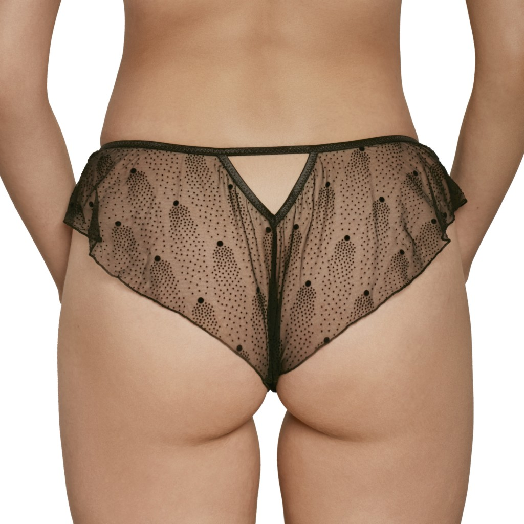 A model shown from the waist down (back view) wears Le Petit Trou Marine briefs. They are made of a sheer black mesh that features a pointillism-style dot pattern.