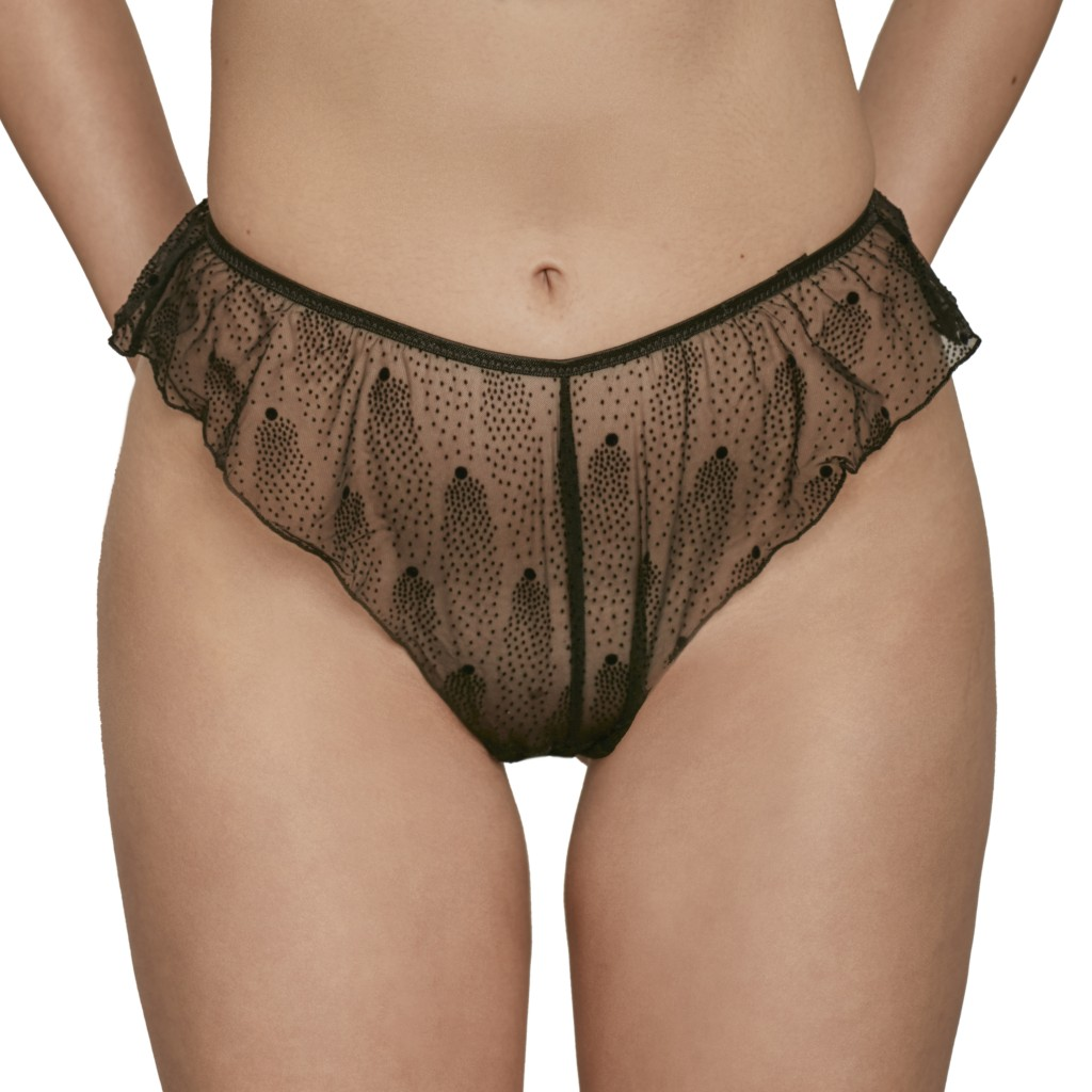 A model shown from the waist down wears Le Petit Trou Marine briefs. They are made of a sheer black mesh that features a pointillism-style dot pattern.