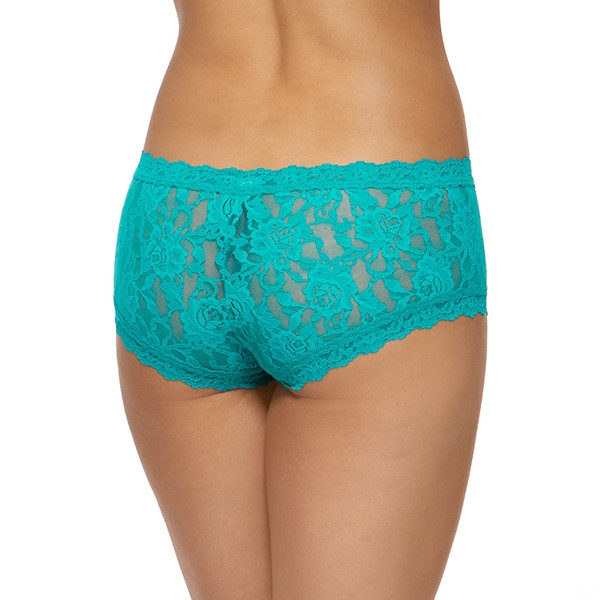 A model shown from the waist down (back view) wears the Hanky Panky Signature Lace Boyshorts in Maui - a bright teal. They are made of a sheer stretch lace.