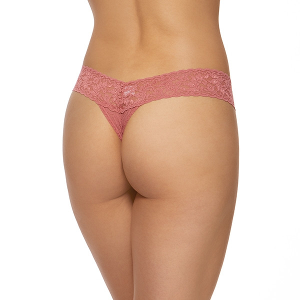 A model shown from the waist down (back view) wears the Hanky Panky Signature lace low Rise thong in a dusty medium pink. It is a stretch lace low rise thong panty.