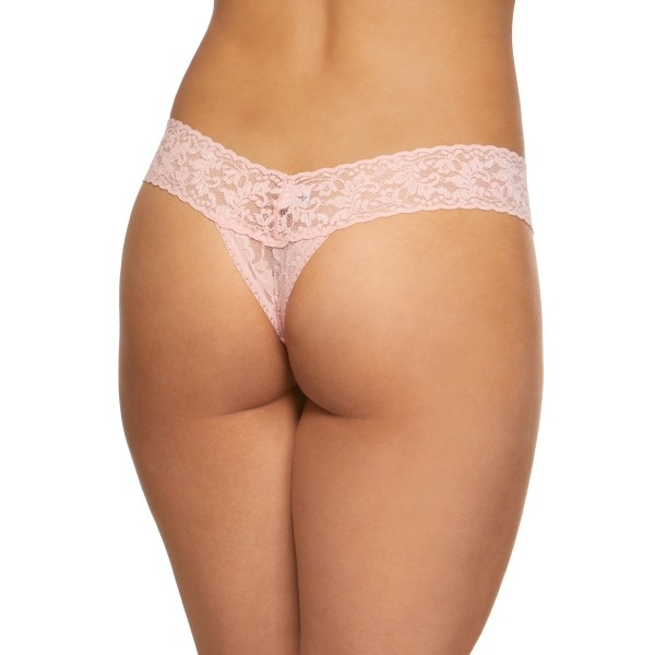 A model shown from the waist down (back view) wears the Hanky Panky Signature lace low Rise thong in a light pink. It is a stretch lace low rise thong panty.
