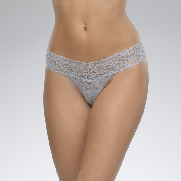 A model shown from the waist down wears the Hanky Panky Signature lace low Rise thong in Steel, a light bluish gray. It is a stretch lace low rise thong panty.