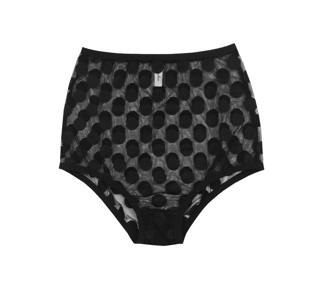 A Flat lay of the high waisted Jeanne panties by Hopeless Lingerie. These retro briefs are sheer, black and feature a large allover polka dot print. They sit high on the waist but the legs are cut low for a pinup girl feel.