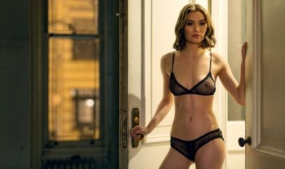 A model stands in a doorway wearing a matching sheer black bra and panty set by Only Hearts.